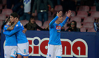 Calcio, Serie A: Napoli vs Juventus. Napoli, stadio San Paolo, 30 marzo 2014. <br /> Napoli forward Jose' Maria Callejon, of Spain, right, celebrates with teammates Lorenzo Insigne, left, and Jorginho, of Brazil, after scoring during the Italian Serie A football match between Napoli and Juventus at Naples' San Paolo stadium, 30 March 2014.<br /> UPDATE IMAGES PRESS/Isabella Bonotto
