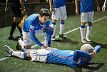 Richard Foster cheekily pretends to massage goalscorer Nicky Law's thigh as they celebrate the second goal for Rangers