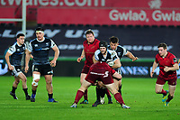 Dan Evans of Ospreys is tackled by Jeremy Loughman of Munster during the Guinness Pro14 Round 16 match between Ospreys and Munster Rugby at the Liberty Stadium in Swansea, Wales, UK. Friday 22 February 2019