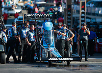 Jul 19, 2019; Morrison, CO, USA; Crew members with NHRA top fuel driver Antron Brown during qualifying for the Mile High Nationals at Bandimere Speedway. Mandatory Credit: Mark J. Rebilas-USA TODAY Sports