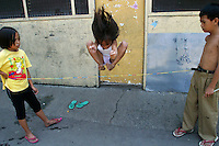 "Kids play ""Chinese garter"" game near the Manila City Jail in Santa Cruz, Manila, Philippines. 9 October 2004"