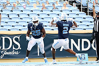 CHAPEL HILL, NC - OCTOBER 10: Javonte Williams #25 of North Carolina celebrates his second touchdown of the game with teammate Dyami Brown #2 during a game between Virginia Tech and North Carolina at Kenan Memorial Stadium on October 10, 2020 in Chapel Hill, North Carolina.