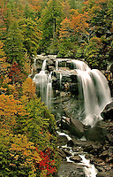 Autumn at the Whitewater waterfall in North Carolina's Blue Ridge Mountains.