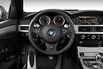 Steering wheel view of a 2008 BMW M5 Sedan