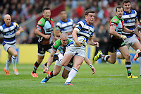 George Ford of Bath Rugby evades the tackle of Mike Brown of Harlequins during the Aviva Premiership match between Harlequins and Bath Rugby at The Twickenham Stoop on Saturday 10th May 2014 (Photo by Rob Munro)