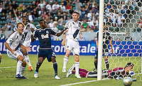 CARSON, CA - June 23, 2012: LA Galaxy midfielder Mike Magee (18) celebrates his goal while teammate Robbie Keane (7) and Vancouver Whitecaps players Gershon Koffie (28) and Joe Cannon (1) look on during the LA Galaxy vs Vancouver Whitecaps FC match at the Home Depot Center in Carson, California. Final score LA Galaxy 3, Vancouver Whitecaps FC 0.