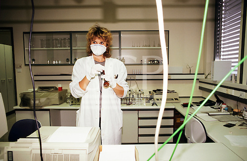 Nr Ljubljana, Slovenia. LEK Pharmaceuticals - worker wearing a mask in the laboratory.