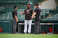 GCL Orioles manager Alan Mills (75) argues a call with umpires Chris Argueza (left) and Chad Patterson (right) during a Gulf Coast League game against the GCL Braves on August 5, 2019 at Ed Smith Stadium in Sarasota, Florida.  GCL Orioles defeated the GCL Braves 4-3 in the first game of a doubleheader.  (Mike Janes/Four Seam Images)