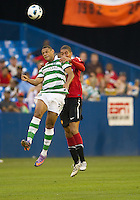 July 16, 2010 Benjamin Hutchison No. 23 of Celtic FC and Chris Smalling No. 12 of Manchester United during an international friendly between Manchester United and Celtic FC at the Rogers Centre in Toronto.
