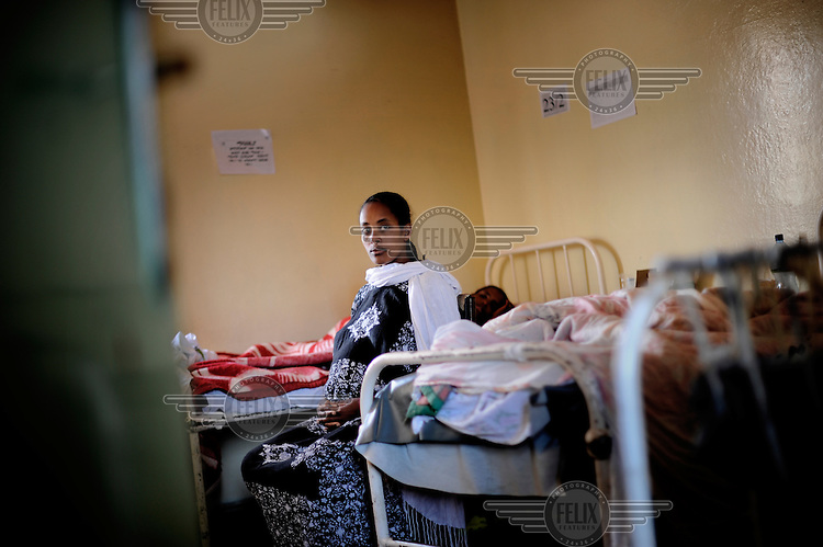 A woman waiting for an examination at the government hospital Gandhi Memorial in Addis Abeba, Ethiopia. For a C-Section in a private clinic, patients have to pay 10 000 Birr (around 450 Euro), unaffordable for most patients. As the government hospital provides care almost free, the demand is too high for the resources available. A quarter of all women have to be turned away, they often have no other choice than to return home and hope for the best.