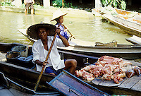 Selling meat at the Floating Market near Bangkok, Thailand.