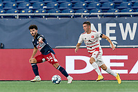 FOXBOROUGH, MA - AUGUST 21: Matt Bolduc #7 of Richmond Kickers dribbles as Ryan Spaulding #34 of New England Revolution II defends during a game between Richmond Kickers and New England Revolution II at Gillette Stadium on August 21, 2020 in Foxborough, Massachusetts.