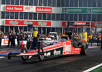 Apr 25, 2014; Baytown, TX, USA; NHRA top fuel dragster driver Leah Pritchett during qualifying for the Spring Nationals at Royal Purple Raceway. Mandatory Credit: Mark J. Rebilas-