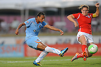 Rosana (11) of Sky Blue FC takes a shot as Cat Whitehill (4) of the Washington Freedom defends. Sky Blue FC and the Washington Freedom played to a 0-0 tie during a Women's Professional Soccer (WPS) match at Yurcak Field in Piscataway, NJ, on July 7, 2010.