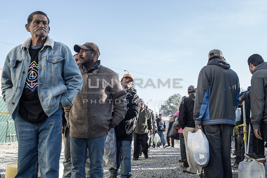 Deportees wait in line for a daily meal at Casa del Padre Chave, a church for homeless who have been deported from US. Tijuana, Mexico. Jan 05, 2015.
