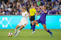 Orlando, FL - Saturday March 24, 2018: Utah Royals defender Katie Bowen (6) plays the ball away from Orlando Pride midfielder Dani Weatherholt (17) during a regular season National Women's Soccer League (NWSL) match between the Orlando Pride and the Utah Royals FC at Orlando City Stadium. The game ended in a 1-1 draw.