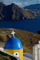 Images from the Book Journey Through Colour and Time,Church at a cliff in Santorini, Greece, a typical blue roof church overlooking the ocean and the Volcanic Cliffs