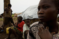 Jolie Moseka (right) was captured by the LRA in Congo. After her release she fled to Nyori refugee camp with her family.
