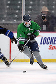 Notre Dame Fighting Irish of Batavia forward Parker Brinkworth (4) during a varsity ice hockey game against the Brockport Blue Devils during the Section V Rivalry portion of the Frozen Frontier outdoor hockey event at Frontier Field on December 22, 2013 in Rochester, New York.  (Copyright Mike Janes Photography)