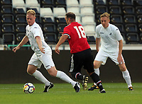 Alan Tate of Swansea (L) is chased by Ben Thornley of Manchester United (C) during the Swansea Legends v Manchester United Legends at The Liberty Stadium, Swansea, Wales, UK. Wednesday 09 August 2017