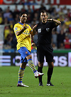 Saturday 28 September 2013<br /> Pictured L-R: Mikel Arteta of Arsenal is protesting to match referee Mark Clattenburg for the yellow card he was shown. <br /> Re: Barclay's Premier League, Swansea City FC v Arsenal at the Liberty Stadium, south Wales.