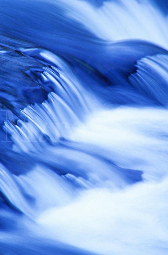 Time exposure water flowing over rocks