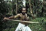 Sajan Gurukkal, the teacher of Arjuna Kalari showing his skills in Kalari Payattu - the ancient marshal art form of Kerala. Cheranaloor, Ernakulam, Kerala, India