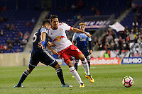 Harrison, NJ - Wednesday Feb. 22, 2017: Matias Laba, Sean Davis during a Scotiabank CONCACAF Champions League quarterfinal match between the New York Red Bulls and the Vancouver Whitecaps FC at Red Bull Arena.