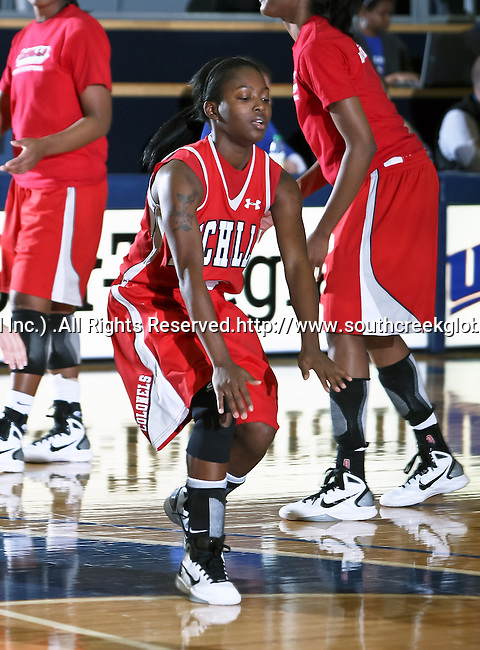 Nicholls State University Colonels guard Ricshamda Bickham (3) comes out onto the floor as she gets introduced before the game between the UTA Mavericks and the  Nicholls State University Colonels  held at the University of Texas in Arlington's Texas Hall in Arlington, Texas. UTA defeats Nicholls 69 to 62
