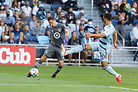 ST. PAUL, MN - AUGUST 21: Ethan Finlay #13 of Minnesota United FC with the cross in front of Luis Martins #36 of Sporting Kansas City during a game between Sporting Kansas City and Minnesota United FC at Allianz Field on August 21, 2021 in St. Paul, Minnesota.