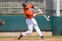 Steve Domecus #26 of the Virginia Tech Hokies makes contact with the baseball at English Field March 27, 2010, in Blacksburg, Virginia.  Photo by Brian Westerholt / Four Seam Images