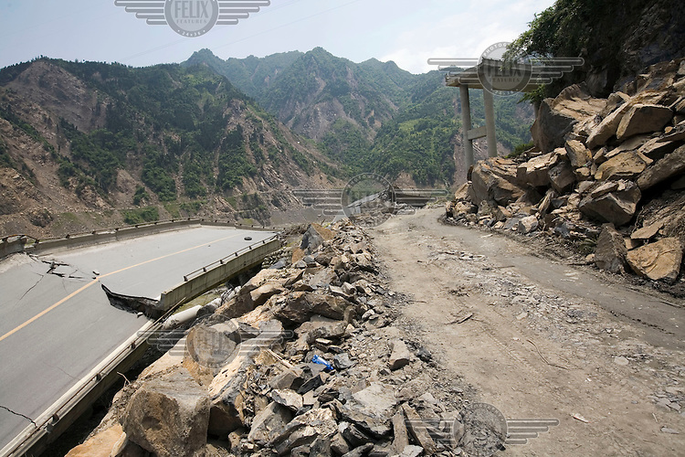 A destroyed highway near the epicentre of the recent Sichuan earthquake of 12/05/2008, which measured 8.0 on the Richter scale. As the rescue effort goes on the death toll continues to rise, with five million people left homeless in Sichuan.