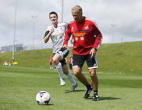 Pictured L-R: Danny McGowan against Alan Curtis. Tuesday 06 May 2014<br /> Re: Members of the local press play football against Swansea City FC coaches and members of staff at the Club's training ground in Fairwood, south Wales.