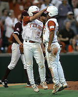 Texas 2B Travis Tucker celebrates scoring a run against Texas A&M with teammate Michael Torres (9) on May 16th, 2008 in Austin Texas. Photo by Andrew Woolley / Four Seam Images.