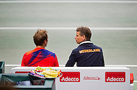 02-02-14,Czech Republic, Ostrava, Cez Arena, Davis Cup Czech Republic vs Netherlands, ,   Thiemo de Bakker (NED) on the bench with captain Jan Siemerink after loosing to Berdych<br /> Photo: Henk Koster