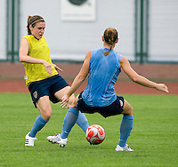 USWNT midfielder Heather O'Reilly tries to get past captain Christie Rampone during practice at Beijing Normal University in preparation for the Olympic gold medal game at Workers' Stadium in Beijing, China.