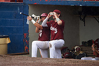 U-Mass Minutemen players Jon Avallone (4) and Hunter Carey (25) in the dugout with props to keep busy during a rain delay against the Lehigh Mountain Hawks on March 19, 2016 at Chain of Lakes Stadium in Winter Haven, Florida.  The game was cancelled due to inclement weather.  (Mike Janes/Four Seam Images)