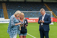 Shirt Sponsors chat during the Wycombe Wanderers 2016/17 Team & Individual Squad Photos at Adams Park, High Wycombe, England on 1 August 2016. Photo by Jeremy Nako.