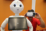 July 20, 2016, Tokyo, Japan - Softbank's subsidiary Asratec employee wears a 3D goggle for the virtual reality demonstration using humanoid robot Pepper's eyes at a press preview of the Pepper World exhibition in Tokyo on Wednesday, July 20, 2016. Pepper's latest applications and accessories will be exhibited at the Pepper World robot exhibition on July 21 and 22.      (Photo by Yoshio Tsunoda/AFLO)