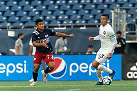 FOXBOROUGH, MA - AUGUST 7: Mateo Rodas #63 of Orlando City B looks to pass as Damian Rivera #72 of New England Revolution II closes during a game between Orlando City B and New England Revolution II at Gillette Stadium on August 7, 2020 in Foxborough, Massachusetts.