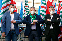 The 3 secretaries of the most important Italian trade unions, Pierpaolo Bombardieri (UIL), Luigi Sbarra (CISL) and Maurizio Landini (CGIL) pose for photographers during the demonstration of the trade unions in Piazza Montecitorio .<br /> Rome (Italy), May 28th 2021<br /> Photo Samantha Zucchi Insidefoto
