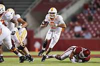 Tennessee quarterback Jarrett Guarantano (2) carries the ball, Saturday, November 7, 2020 during the first quarter of a football game at Donald W. Reynolds Razorback Stadium in Fayetteville. Check out nwaonline.com/201108Daily/ for today's photo gallery. <br /> (NWA Democrat-Gazette/Charlie Kaijo)
