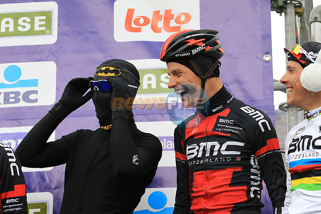 Taylor Phinney (USA) BMC Racing Team rider disguised as Batman and World Champion Philippe Gilbert (BEL) on the podium with temperatures at -3 and wind chill of -16 at the sign on before the 75th edition of Gent-Wevelgem in Deinze, Belgium, 24th  March 2013 (Photo by Eoin Clarke 2013)