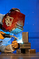A welder working at Max Daetwyler Corporation, which manufactures equipment and products for the printing industry, including pressroom applications in the gravure and flexographic industry. The founders of Daetwyler USA started the company in 1975. Located in Huntersville, NC, the manufacturing company employs more than 70 people.