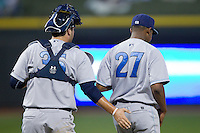 Wilmington Blue Rocks catcher Cam Gallagher (35) gives encouragement to starting pitcher Miguel Almonte (27) during the game against the Winston-Salem Dash at BB&T Ballpark on April 3, 2014 in Winston-Salem, North Carolina.  The Blue Rocks defeated the Dash 3-1.  (Brian Westerholt/Four Seam Images)