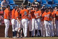 John Hicks #8 of the Virginia Cavaliers is congratulated by his teammates at Wake Forest Baseball Park March 8, 2009 in Winston-Salem, NC. (Photo by Brian Westerholt / Four Seam Images)