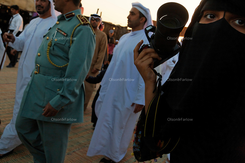 Photographers and curious bystanders surround Sheik Tahnoon Bin Mohamed --Ruler of Alain--as he arrives at the Souk area of the camel beauty contest with his son Sheik Sultan Bin Tahnoon who is head of ADACH (Abu Dhabi Assoc. of Culture and Heritage) and ADTA Tourist Authority.