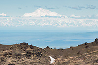 Hikers view Denali from a ridge in the Chugach Mountains 140 miles away.