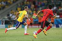 Brazil's Neymar Takes on Mexico's Jose VazQuez