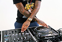 Pictured: Leroy Fer on his dj decks at his home near Swansea, Wales, UK.<br /> Re: Footballer Leroy Fer of Swansea City FC is a keen DJ.